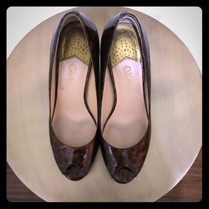 Cole Haan leopard patent leather work pumps.